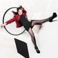 Leggy girl posing studio laying floor legs raised up Stock Image