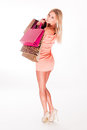 Leggy shopper full figure portrait of beautiful sexy blond woman with colorful shopping bags Stock Photography