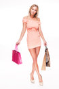 Leggy shopper full figure portrait of beautiful sexy blond woman with colorful shopping bags Stock Photos