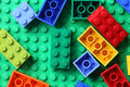 Lego blocks on green baseplate tambov russian federation june a trademarked in capitals as is a popular line of Stock Image