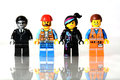 The lego movie mini figures on isolated background is an interlocking brick system collected around world by adults and Royalty Free Stock Image