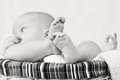 Legs of the baby lying in a basket on a light background black and white Royalty Free Stock Image