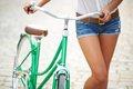 Legs of bicyclist close up young woman with bicycle Royalty Free Stock Image