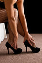 Legs with black high heal shoes and fishnet stockins woman Stock Photography