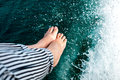 Legs on the boat in nature lake Royalty Free Stock Photo