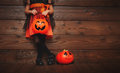 Legs of child girl in witch costume  for Halloween with pumpkin Royalty Free Stock Photo