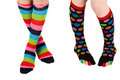 Legs with colorful stockings Royalty Free Stock Photos