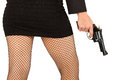 Legs of dangerous woman with handgun and black shoes fishnet stockings Royalty Free Stock Photography