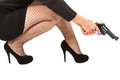 Legs of dangerous woman with handgun and black shoes fishnet stockings Stock Image