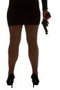 Legs of dangerous woman with handgun and black shoes silhouette stockings Stock Images