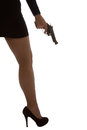 Legs of dangerous woman with handgun and black shoes silhouette stockings artistic conversion Stock Images