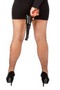 Legs of dangerous woman with handgun and black shoes stockings Royalty Free Stock Photo