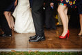 Legs down image of people dancing at wedding reception a on a wood dance floor outdoors shot from about the knee Stock Photography
