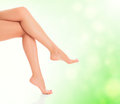 Legs on green blurred background. Royalty Free Stock Photos