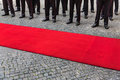 Legs of guard of honor and red carpet Royalty Free Stock Photo