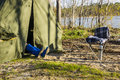 Legs in gumboots sticking out of tent Royalty Free Stock Photo