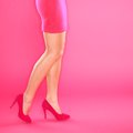 Legs and pink high heels shoes Royalty Free Stock Images