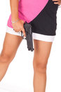 Legs and pistol Royalty Free Stock Photo