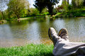 Legs beside a pond beautiful scenic view of Stock Images