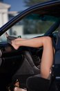 Legs of sexy woman in car sat with feet on dashboard Royalty Free Stock Photography