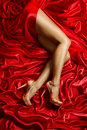 Legs Shoes High Heels on Red Cloth, Sexy Woman Silk Dress Fabric Royalty Free Stock Photo