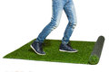 Legs stepping on artificial grass isolated on white коп Royalty Free Stock Photo