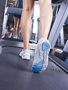 Legs on treadmill female s running Royalty Free Stock Photos