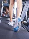 Legs on treadmill female s running Royalty Free Stock Photos