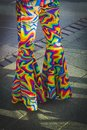 Legs in vibrant colorful trousers of 70s, disco,vintage Royalty Free Stock Photo