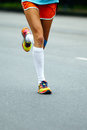Legs woman runner Royalty Free Stock Photo