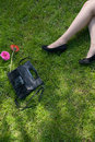 Legs of a women resting on green grass Royalty Free Stock Photo