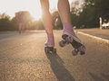 Legs of young woman roller skating in park Royalty Free Stock Photo