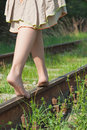 Legs of young woman walking on rail barefoot Royalty Free Stock Image
