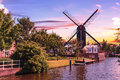 Leiden inhouse city windmill sunset on park de put in the center of the of netherlands Royalty Free Stock Images