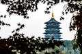 Leifeng Pagoda is a five stories tall tower with eight sides, located on Sunset Hill south of the West Lake in Hangzhou, China. Royalty Free Stock Photo