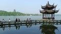 Leifeng Pagoda with stone bridge in West Lake Royalty Free Stock Photo