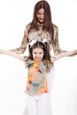 Leisure activity sisters on white background Royalty Free Stock Photography