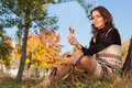 Leisure in autumn park young woman enjoy beuty nature sitting the Royalty Free Stock Photo