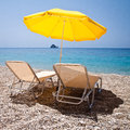 Leisure on the beach sun parasol and sun loungers Stock Image
