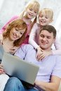 Leisure image of happy family together looking at laptop Royalty Free Stock Images