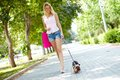 Leisure portrait of happy female strolling with her pet at Royalty Free Stock Photo