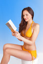 Leisure reading girl on beach holiday Royalty Free Stock Image
