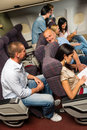Leisure travel people enjoy flight airplane cabin talking passengers Royalty Free Stock Images
