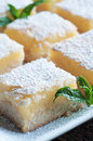 Lemon bars fresh baked meyer with powdered sugar Stock Photos