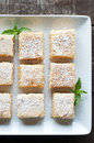 Lemon bars fresh baked meyer with powdered sugar Stock Photo