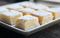 Lemon bars fresh baked meyer with powdered sugar Stock Image