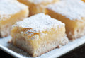 Lemon bars fresh baked meyer with powdered sugar Stock Images