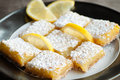 Lemon bars zesty sweet with garnish and confectioner s sugar Stock Image