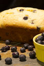 Lemon blueberry bread on slate with loose blueberries around and a yellow bowl with blueberries in it Royalty Free Stock Image