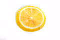 Lemon with bubbles in soda Royalty Free Stock Photo